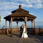 A bride and groom on the gazebo and pier