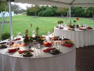 Tables with Orange and Green Centerpieces